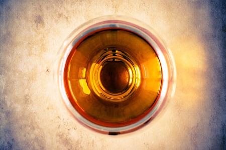 cognac: Cognac, brandy in the glass top view Stock Photo