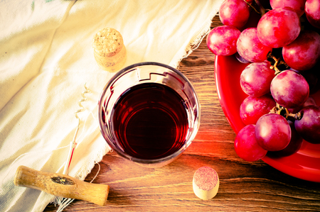 Glass of red wine on the table top view