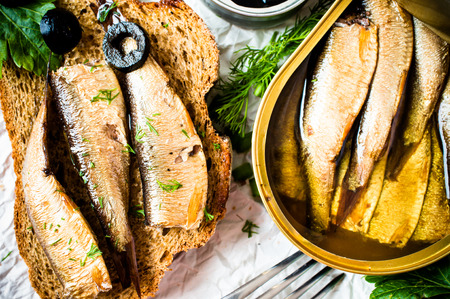 sardines: Sandwich, tapas with sardines, sprats with olives and herbs Stock Photo