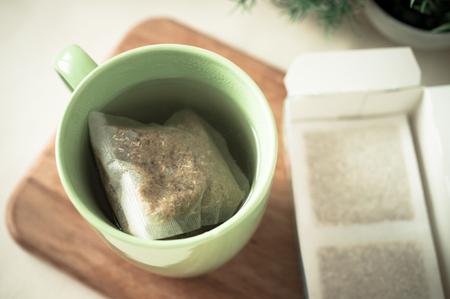 herbs boxes: Bag of herbs brewed in a mug