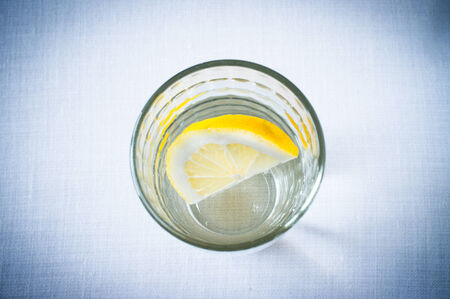 fruit in water: Glass of clean water with a slice of lemon view from above