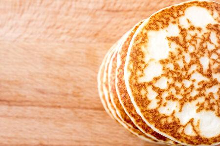 top veiw: Pancakes stacked on a wooden table. Top veiw
