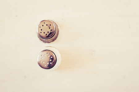 salt and pepper: Salt and pepper on a white table top view Stock Photo