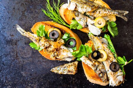 sprats: Sandwiches, tapas with grilled fish, capelin, sprats, sardines Stock Photo