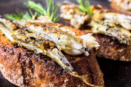 sardines: Sandwiches, tapas with grilled fish, capelin, sprats, sardines Stock Photo