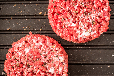 minced meat: Frozen beef burger, hamburger, minced Stock Photo