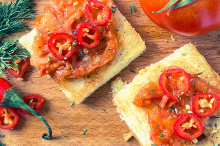 hot peppers: Toasts with roasted tomatoes and hot peppers Stock Photo