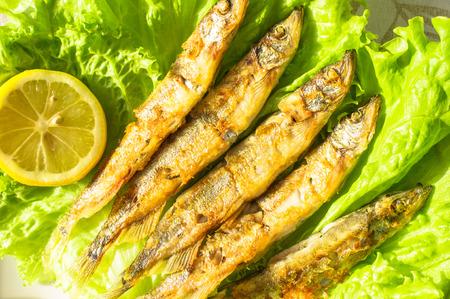 sardines: Grilled sardines on lettuce and lemon