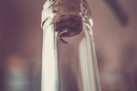 incorrect: Incorrect opening pierces through wine corkscrew wine cork. Pastel colors filter