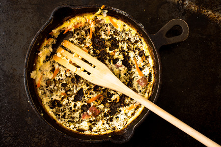 leftovers: Empty pan of omelet with a wooden fork. omelette leftovers
