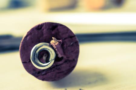 sommeliers: Pierced cork corkscrew red wine through Stock Photo