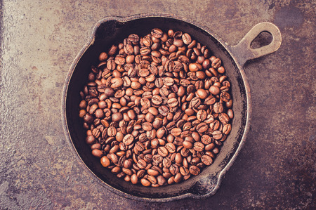 roasting: Frying pan with coffee beans during roasting Stock Photo