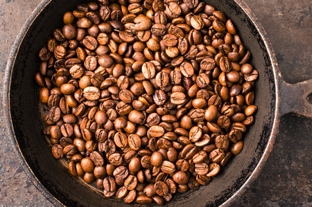 stove top: Coffee beans during cooking on the stove top view Stock Photo