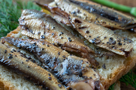fish dinner: Smoked fish on bread with dill in a rustic style