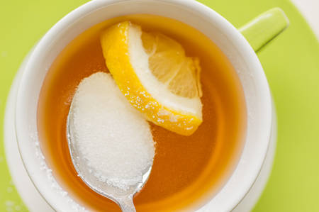 substitute: Spoon with sugar substitute, sorbitol dissolved in a cup of tea with lemon