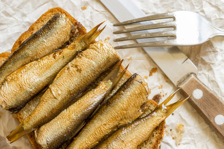 sardines: Rustic breakfast, lunch sandwich with sardines. Top view Stock Photo