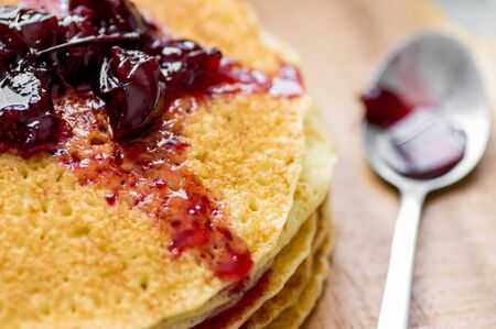flapjacks: Cherry jam on blini - pancakes closeup