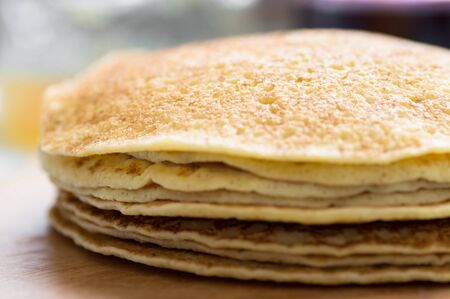 flapjacks: Russian blini - pancakes pile on the table