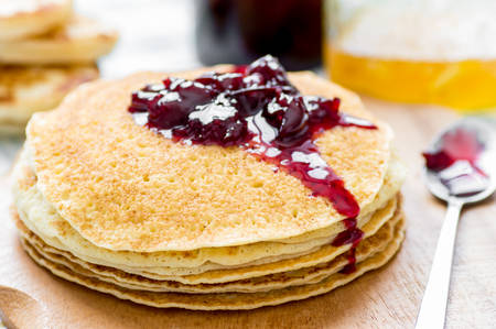 blini: Cherry jam on a stack of pancakes Russian blini on the table Stock Photo