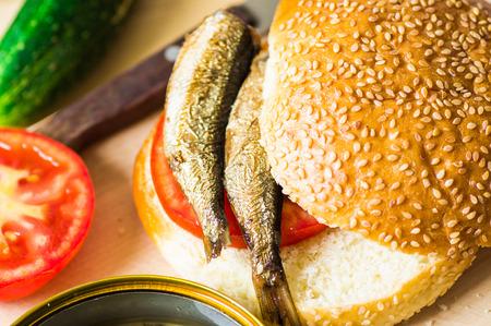 sardines: Sandwich with smoked sardines and tomatoes, cucumbers