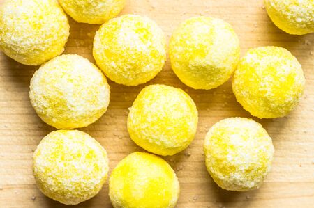 gumballs: Candy lemon yellow on the table top view