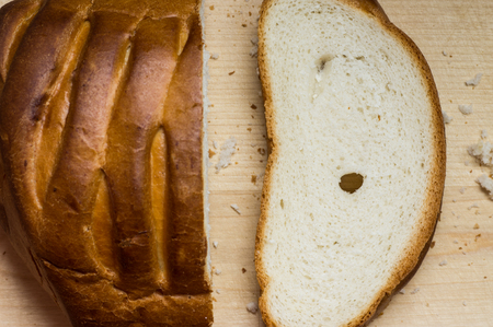 cut off: Cut off a piece of loaf bread top view