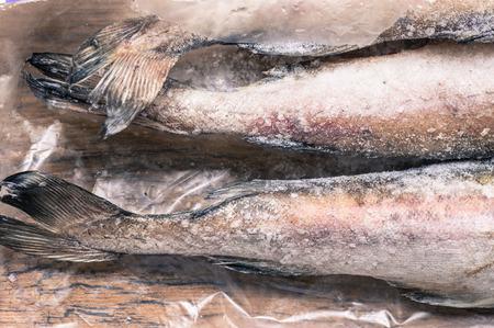 frozen fish: Tails frozen fish pollock top view Stock Photo