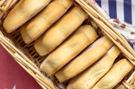 milk and cookies: Stack of milk cookies in a wicker basket top view Stock Photo