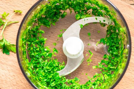 food processor: Chopped fresh herbs  parsley in a blender top view