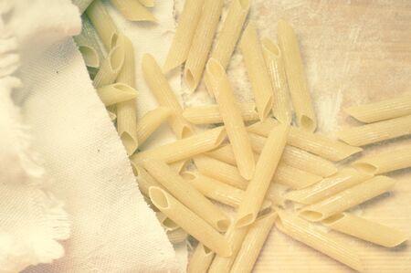 maccheroni: Macaroni pasta dry poured from cloth bags