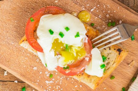 stemming: Ciabatta with poached egg yolk stemming top view Stock Photo