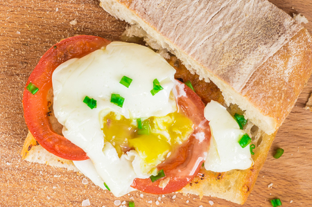ciabatta: Toasted ciabatta sandwich with eggs and tomatoes with leek