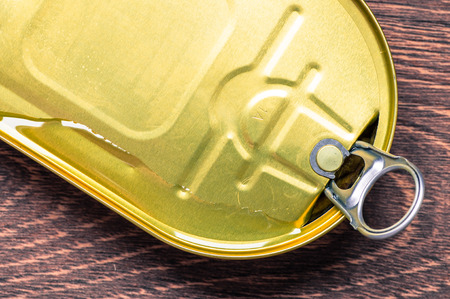 sardine can: Oil flows when opening a tin can top view