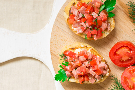 bruschetta: Tasty appetizer crostini (crostino) with tomato and sausage Stock Photo
