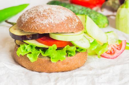 vegetarian hamburger: Burger with vegetables, vegburger with zucchini, eggplants, cucumbers and tomatoes Stock Photo