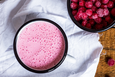red currant: Smoothies berries of red currant in a mug rustic style