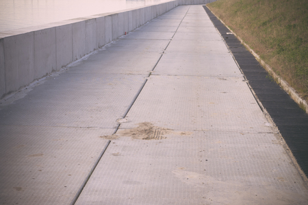 beton: Embankment concrete slabs dam on the river