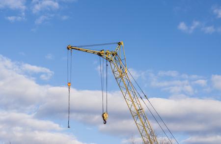 mobile crane: Mobile crane boom against the blue sky