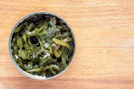 vegetable tin: Seaweed in the tin on the table top view