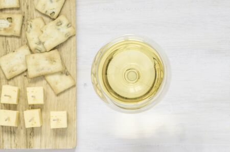 white wine: White wine with cheese and snacks top view