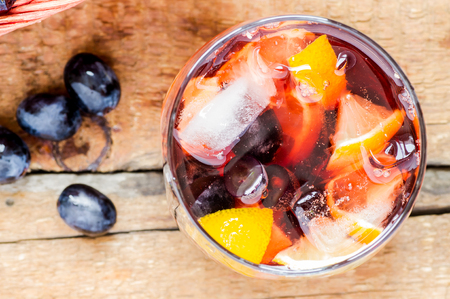 grape juice: Sangria in a glass with grapes closeup