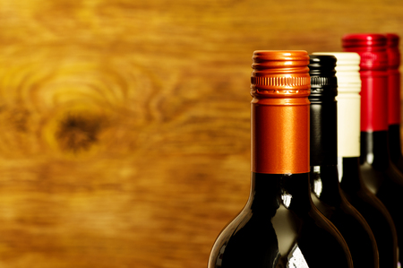 black cap: Tops of wine bottles with screw caps for background Stock Photo