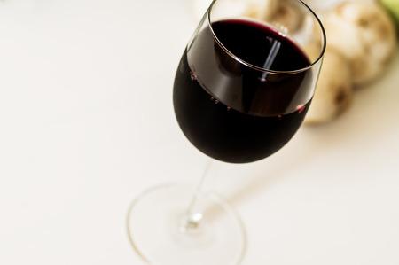 merlot: Glass of red wine Merlot on the white table
