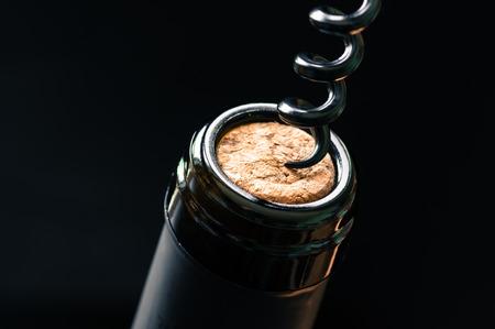 uncork: Cork bottle wine with corkscrew closeup