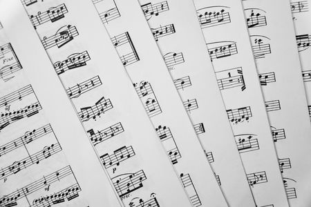 Shot of seven scattered music scores books. photo