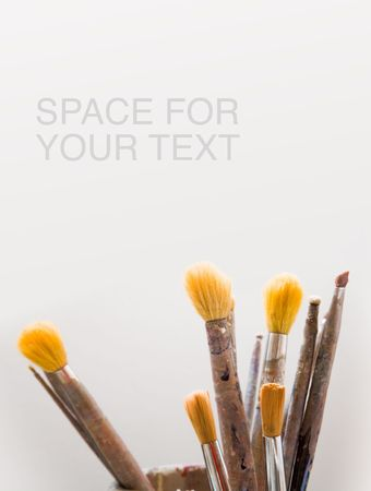Paint brushes with plenty of copy space. Stock Photo