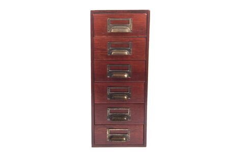 Antique six drawer oak library file card cabinet with brass label holders isolated over white background. photo