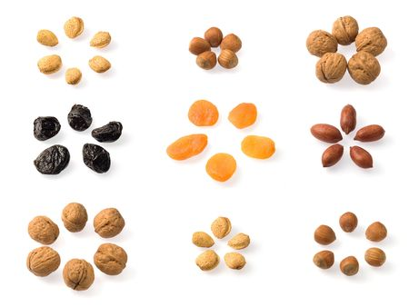 Whole dried fruits collection over white. Includes almonds, hazelnuts, pecans, walnuts, prunes and dried apricots. Includes almonds, hazelnuts, pecans, walnuts, prunes and dried apricots. Stock Photo - 6485961