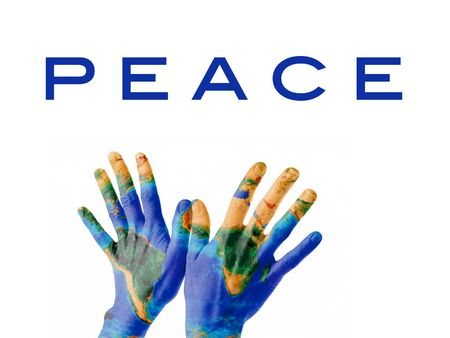 A pair of hands on a bird-kind position, painted as the Earth planet and symbolizing Peace on Earth.