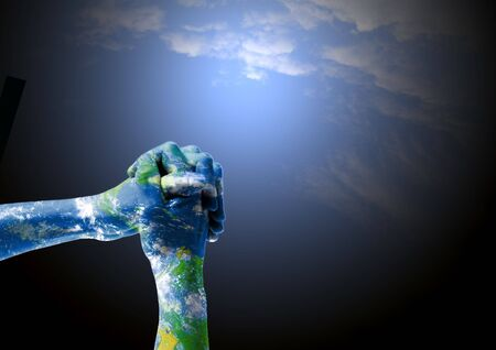 merged: Hands on praying position merged with a satelital image of the planet as symbol of empathy for Earth. Stock Photo